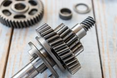 Gear wheels on a wooden table Royalty Free Stock Images