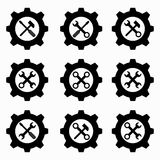 Gear and wrenches black icons Stock Photos