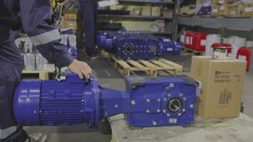 Gearbox assembly process. Gearboxes assembly at the factory. Gear motors manufacturing