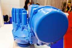 Gearbox on large electric motor. At industrial equipment plant stock photography