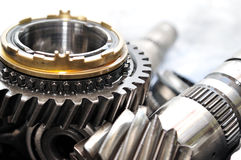 Gearbox parts. Transmission wheels and axle from car gearbox Stock Photo