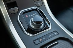 Gearbox gearbox selector in the form of a retractable washer in the center console stock photos