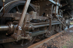 Gearing steam train on tracks. The mechanical part of the steam train on tracks Stock Image