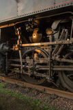 Gearing steam train on tracks. The mechanical part of the steam train on tracks Royalty Free Stock Photography
