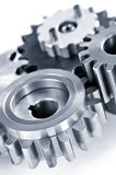 Gears. Interlocking industrial metal gears isolated on white Stock Photos
