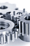 Gears. Interlocking industrial metal gears isolated on white Stock Image