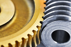 Gears. Industrial metal gears and machine parts connected Royalty Free Stock Photos