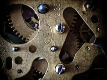 Gears. Clockwork, gears and screws. Mechanical structure stock photo