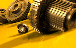 Gears. A gear mechanism on a yellow Stock Image