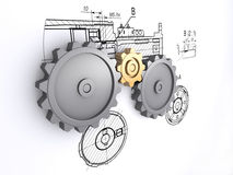 Gears. Two big metallic gray and one small golden gears against a background of engineering drawings with shadow