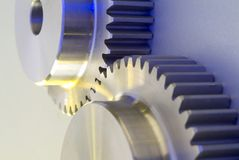 Gears. Sincronization of industrial gears on white background