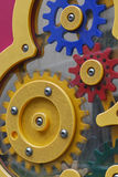 Gears. A gear train concept made of plastic at a playground Royalty Free Stock Photos