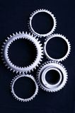Gears. Of several sizes interlock to turn each other Stock Photos