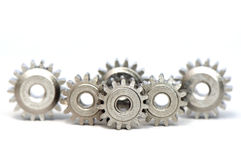 Gears. Multiple gears row on white background Royalty Free Stock Image