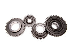 Gears. Four gears meshing together over white Royalty Free Stock Images