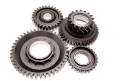 Gears. Four gears meshing together over white Royalty Free Stock Photos