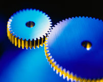 Gears. Two gears with blue and yellow reflections Royalty Free Stock Photos