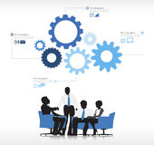 Gears Above Four Business People Royalty Free Stock Photos