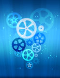 Gears on abstract background with glowing beam. Stock Photos