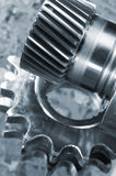 Gears against computer-board Royalty Free Stock Photos