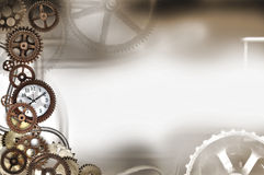 Gears background. An assortment of old gears large and small with a clock within the gears Stock Photo
