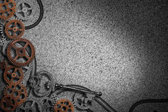 Gears background with key. An assortment of metal gears on a textured background with a large metal key Royalty Free Stock Photo