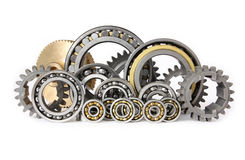 The gears and bearings. This photo shows the gears and bearings on white background royalty free stock photo