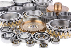 The gears and bearings. This photo shows the gears and bearings on white background royalty free stock photos