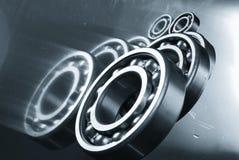 Gears, bearings against mirror Stock Photo