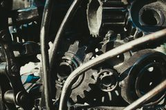 The gears and bearings are assembled in one piece for the purposes of art. Different parts of the machines are made of iron. The gears and bearings are royalty free stock photos
