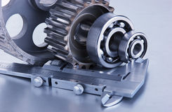 Gears and bearings with calipers Stock Photo