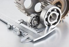 Gears and bearings with calipers. On a metal plate stock images