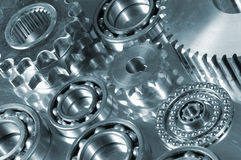 Gears and bearings on display. In a dark duplex metallic blue toning, slightly tilted perspective stock photography