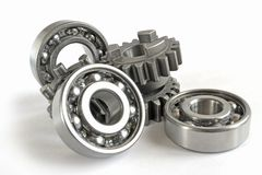 Gears and bearings. On the white background stock photography