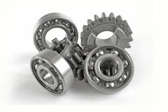 Gears and bearings. On the white background stock images