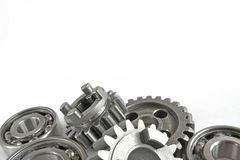 Gears and bearings. On the white background stock photos