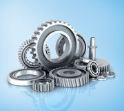 Gears and bearings isolated blue background. Royalty Free Stock Photo