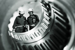 Gears, bearings, technology and workers Stock Photography
