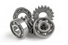 Gears and bearings. On the white background stock photo