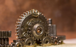 Gears being lubricate. Gears with mutch oil lubricant on them Royalty Free Stock Image