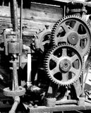 Gears in black and White. Rusted and forgotten gears of an old water wagon. Interlocking gears used to drive the pump, now useless and nearly forgotten Royalty Free Stock Image