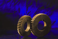 Gears on blue Stock Photos