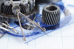 Gears On Blueprint. Engineering concept. Set of gears near divider on blueprint royalty free stock photography