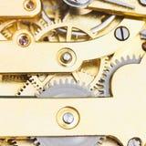 Gears of brass mechanical clockwork of retro watc. H close up Royalty Free Stock Image