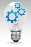 Gears in bulb Royalty Free Stock Image