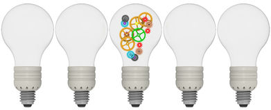 Gears in bulb. The concept of generating ideas Royalty Free Stock Image