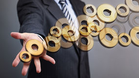 Gears of business. Businessman with gears concept for leadership, organization and business strategy Royalty Free Stock Image