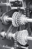 Gears and chain. Large gear-machinery being powerd by strong timing-chain stock photography
