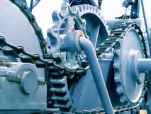 Gears and Chains on Machine. Complex machine with gears and chains royalty free stock images