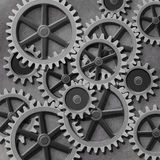 Gears and Cogs. A Mechanical Background with Gears and Cogs Royalty Free Stock Image